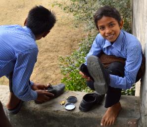 Boys polishing shoes